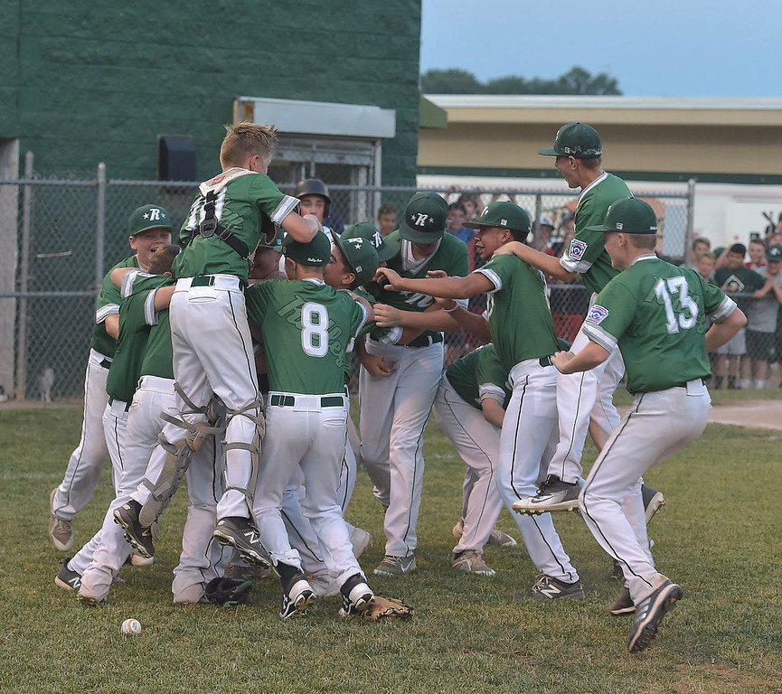 . PETE  BANNAN-DIGITAL FIRST MEDIA      Ridley Area players celebrate their 13-7 victory over Aston Middletown in the deciding game of the District 19 Little League Majors tournament Tuesday evening.