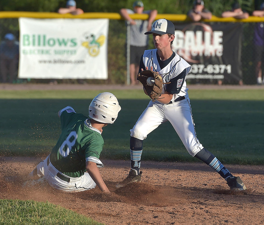 . PETE  BANNAN-DIGITAL FIRST MEDIA       Ridley area (8) Irv Fisher slides into second ahead of the grab by Aston Middletown shortstop Sam Diddons in District 19 Little League Majors tournament  Monday evening  Aston went on to win 4-1. The teams will compete again Tuesday night.