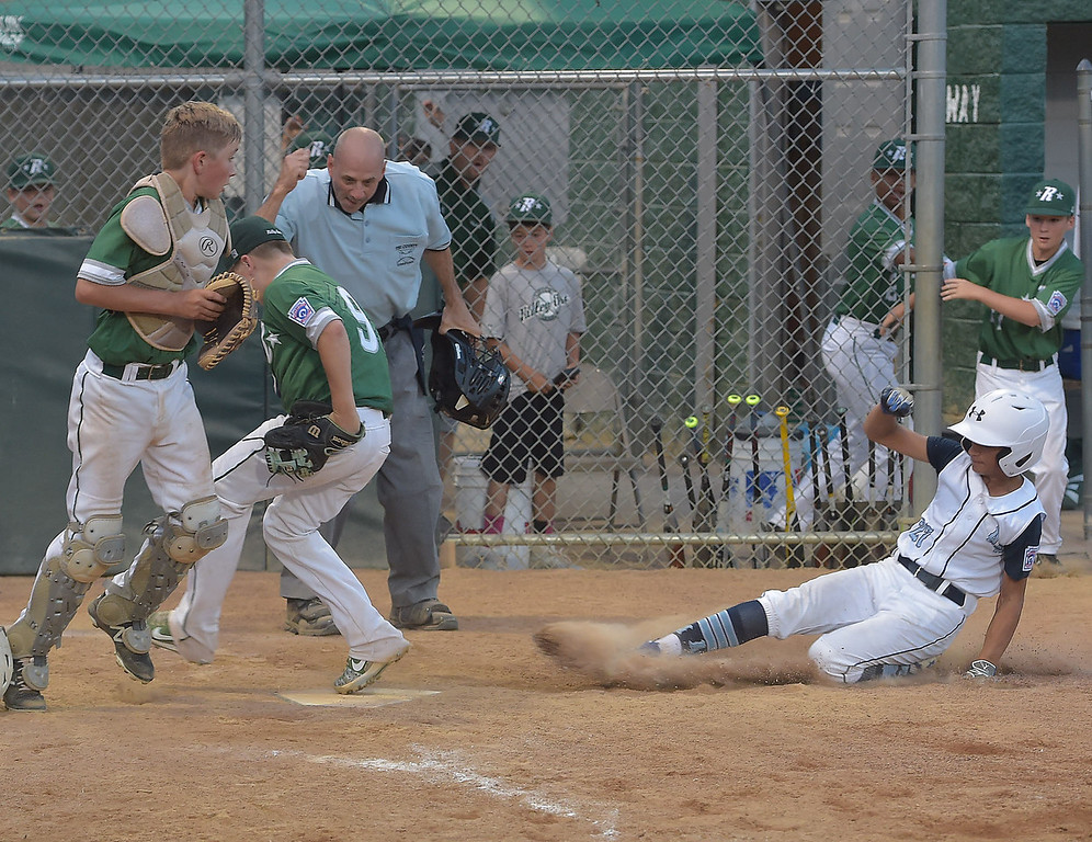 . PETE  BANNAN-DIGITAL FIRST MEDIA      Ridley Are pitcher Jaxan Kahoe beats Aston Middletown runner (27) Niko Tozi to home plate for the final out in the deciding game of the District 19 Little League Majors tournament Tuesday evening.