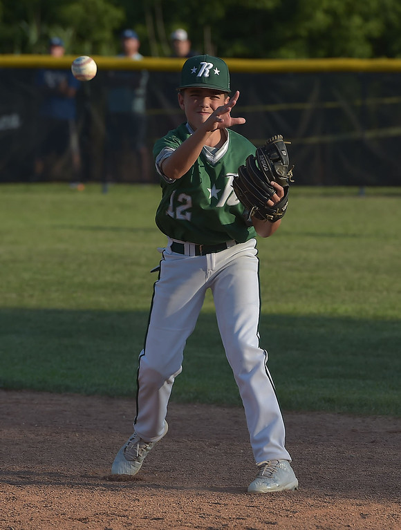 . PETE  BANNAN-DIGITAL FIRST MEDIA      Ridley Areasecond baseman Conner Scanlan throws out a runner in the fourth inning of their 13-7 victory over Aston Middletown in the deciding game of the District 19 Little League Majors tournament Tuesday evening.