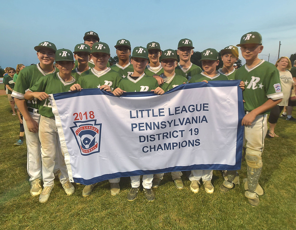. PETE  BANNAN-DIGITAL FIRST MEDIA      Ridley Area players hold the Championship banner after their 13-7 victory over Aston Middletown in the deciding game of the District 19 Little League Majors tournament Tuesday evening.
