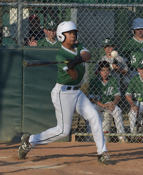 PETE  BANNAN-DIGITAL FIRST MEDIA      Ridley Area hitter T.C. Cobb connects for a grand slam in the third inning to put his team up 5-3 in their  13-7 victory over Aston Middletown in the deciding game of the District 19 Little League Majors tournament Tuesday evening.