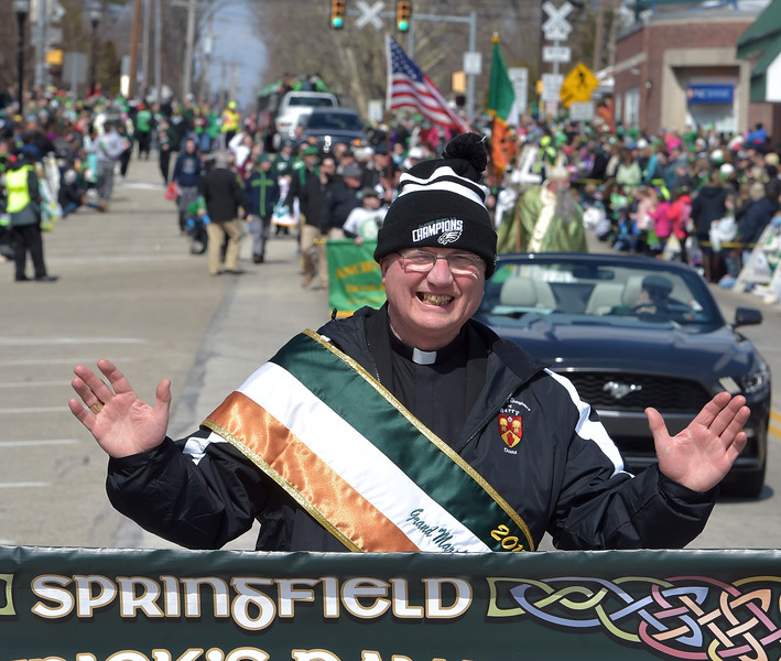 PETE  BANNAN-DIGITAL FIRST MEDIA      Springfield's St. Patrick Day Grand Marshall Bishop Donal McKeown  leads the parade down Saxer Ave. Saturday as thousands turned out for the parade.