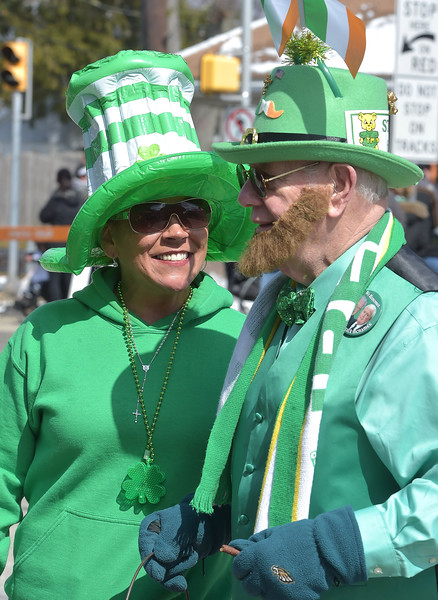 PETE  BANNAN-DIGITAL FIRST MEDIA      Veronica Hally of Havertown takes a shine to Bob Nerch as he handed out candy from his pot-o-gold at Springfield's St. Patrick Day parade.