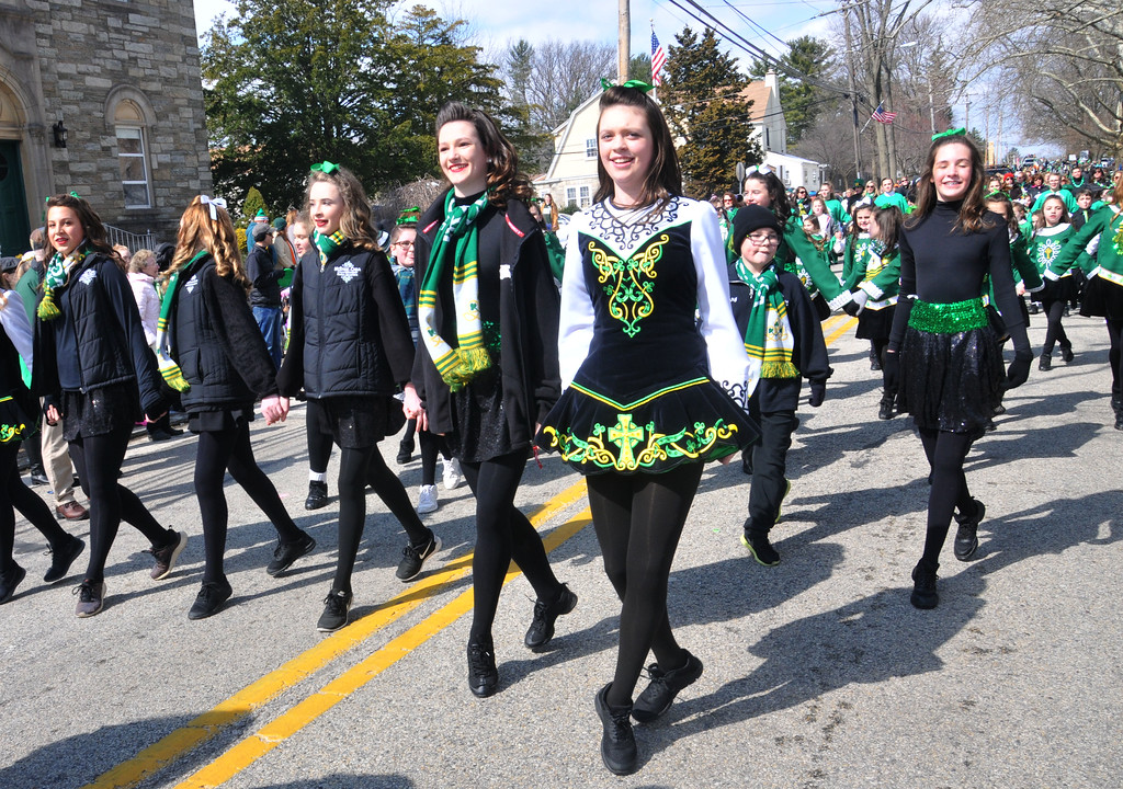 . PETE  BANNAN-DIGITAL FIRST MEDIA      Caitlyn Coile of Havertown ,center, joined her fellow dancers from McKenna-Cara School of Irish Dance at Springfield\'s St. Patrick Day Saturday.
