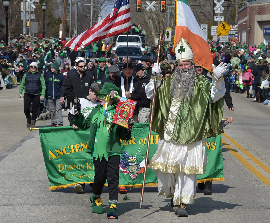 . PETE  BANNAN-DIGITAL FIRST MEDIA   Pat and John Cooke march with the Ancient Order of Hibernians at Springfield\'s St. Patrick Day Saturday.
