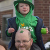 PETE  BANNAN-DIGITAL FIRST MEDIA      Frank Friday found a good spot for his Irish cap tattoo with his son Lex,3, on his shoulders at Springfield's St. Patrick Day Saturday.