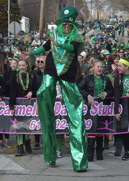 PETE  BANNAN-DIGITAL FIRST MEDIA     Carmela Mayo marched the entire  Springfield's St. Patrick Day parade route on her stilts with her dance studio dancers.