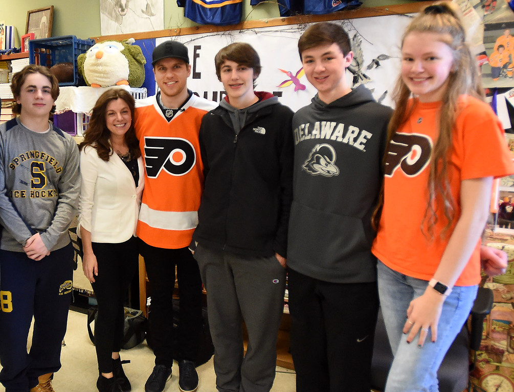 . PETE  BANNAN-DIGITAL FIRST MEDIA     Springfield student Aiden Smith, teach Denise Mroz, Philadelphia Flyers forward, Braydon Schenn, students Kevin Brown, Scott Oslar and Erica Offermann.