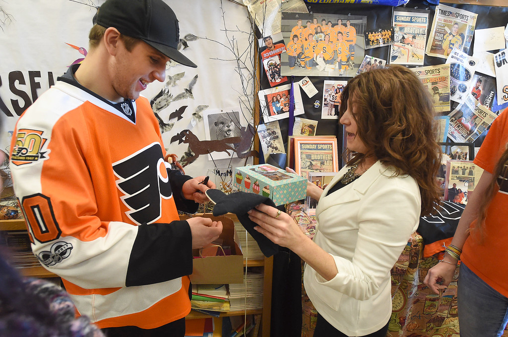 . PETE  BANNAN-DIGITAL FIRST MEDIA         Philadelphia Flyers forward, Braydon Schenn gets  cookies from Springfield Language Arts teacher and avowed hockey nut, Denise Mroz who coined the term �Schennergy�.