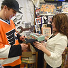 PETE  BANNAN-DIGITAL FIRST MEDIA         Philadelphia Flyers forward, Braydon Schenn gets  cookies from Springfield Language Arts teacher and avowed hockey nut, Denise Mroz who coined the term 'Schennergy'.