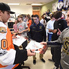 PETE  BANNAN-DIGITAL FIRST MEDIA       Philadelphia Flyers forward, Braydon Schenn,gives sophomore Aiden Smith an autographed photo.
