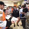 PETE  BANNAN-DIGITAL FIRST MEDIA       Philadelphia Flyers forward, Braydon Schenn,gives sophomore Aiden Smith an autographed photo.