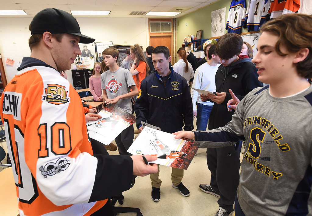 . PETE  BANNAN-DIGITAL FIRST MEDIA       Philadelphia Flyers forward, Braydon Schenn,gives sophomore Aiden Smith an autographed photo.