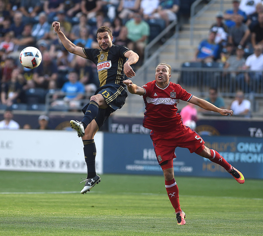 . PETE BANNAN-DIGITAL FIRST MEDIA   The Union\'s Chris Pontius out jumps Chicago\'s  Michael Harrington in the Union\'s 4-3 victory over the Chicago Fire at Talen Energy stadium in Chester Wednesday June 22, 2016.