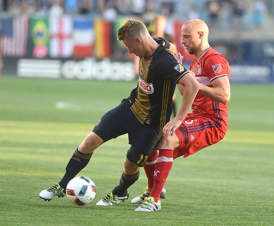 . PETE BANNAN-DIGITAL FIRST MEDIA   The Philadelphia Union\'s Fabian Herbers keeps the ball away from the Chicago Fire\'s Eric Gehrig in the first half of the Union\'s 4-3 victory at Talen Energy Stadium June 22, 2016.