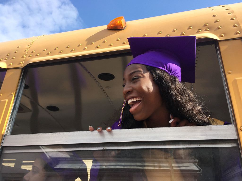 . PETE  BANNAN-DIGITAL FIRST MEDIA         Jasmine Valentin took her last bus ride as a Upper Darby student to commencement at the Tower theater Thursday morning.