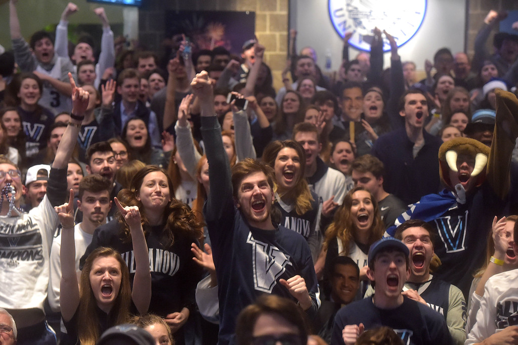 . PETE  BANNAN-DIGITAL FIRST MEDIA Villanova students cheer their Wildcats on at the Connelly Center in the first half of the National Championship game.