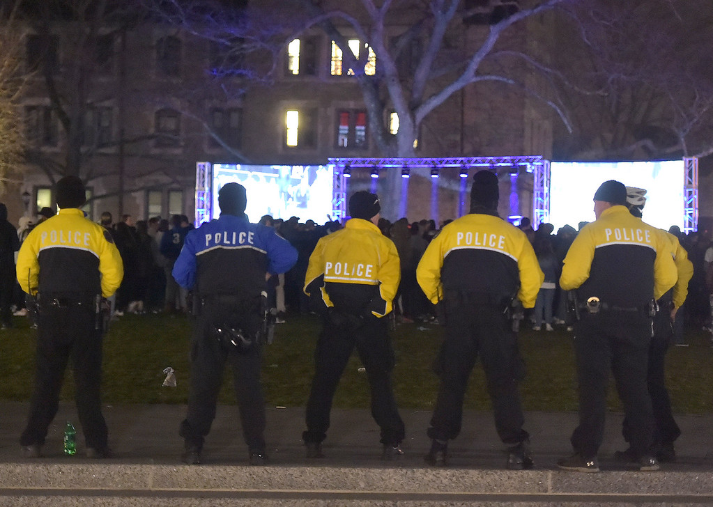 . PETE  BANNAN-DIGITAL FIRST MEDIA      Police officers standby on the Villanova Quad as  students watch the WIldcats play in the National Championship game.