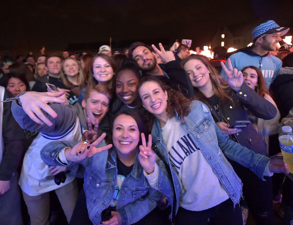. PETE  BANNAN-DIGITAL FIRST MEDIA      Villanova students watch the National Championship game on the  the campus Quad outside the Connelley Center. Officials worked to keep celebrations off Lancaster Avenue.