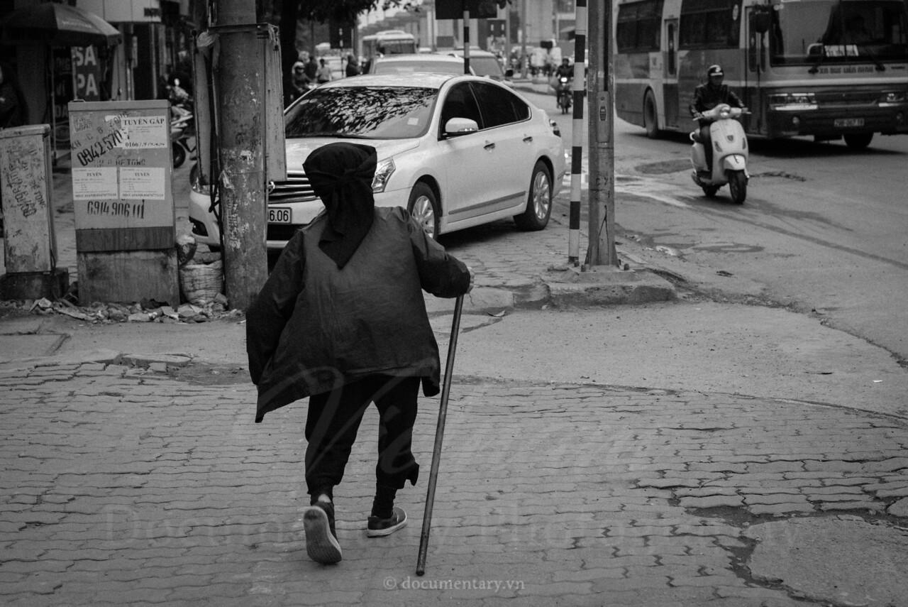 Old woman on sidewalk