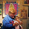 Veronica Karla Martinez, from Las Vegas, teaches her grandaughter, Heaven Jade Ortega, 13 months, how to pray at the Santuario de Chimayo on April, 1, 2010. Martinez has been making the pilgrimage for 30 years.            Luis Sanchez Saturno/ The New Mexican.