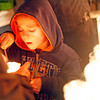 Dolores Roybal, from Santa Cruz, holds a candle as her grandson, Julian Bourguet, 5, lights it at the Santuario de Chimayo on April, 1, 2010.            Luis Sanchez Saturno/ The New Mexican.