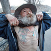 Michael Joseph Trujillo, 62, shows off his tattos shortly after arriving at the Santuario de Chimayo on April, 1, 2010, at 7:00 a.m.            Luis Sanchez Saturno/ The New Mexican.
