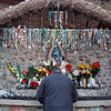 Pilgrim Ronnie Leyba, 55, from Santa Fe, prays at one of the Shrines outside the Santuario de Chimayo shortly after arriving on April, 1, 2010, at 7:00 a.m. Leyba has been making the pilgrimage annually since 1971.            Luis Sanchez Saturno/ The New Mexican.