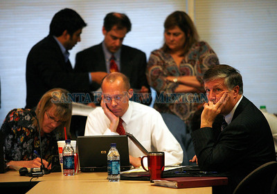 School board votes on closing/consolidating small schools in Santa Fe, N.M., on April 22, 2010. (l-r) Denise Johnston (associate superintendent), Mel Morgan (deputy superintendent) and Michael Erwin (chief financial officer) Natalie Guillen/The New Mexican