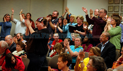 School board votes on closing/consolidating small schools in Santa Fe, N.M., on April 22, 2010. **Bobbie Guiterrez responds, eliciting a standing ovation from 90% of the crowd. Natalie Guillen/The New Mexican