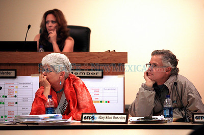 School board votes on closing/consolidating small schools in Santa Fe, N.M., on April 22, 2010. Angelica Ruiz, (above), Mary Ellen Gonzales (left) and Richard Polese (right) listen as the public expresses their opinion in a forum. Natalie Guillen/The New Mexican