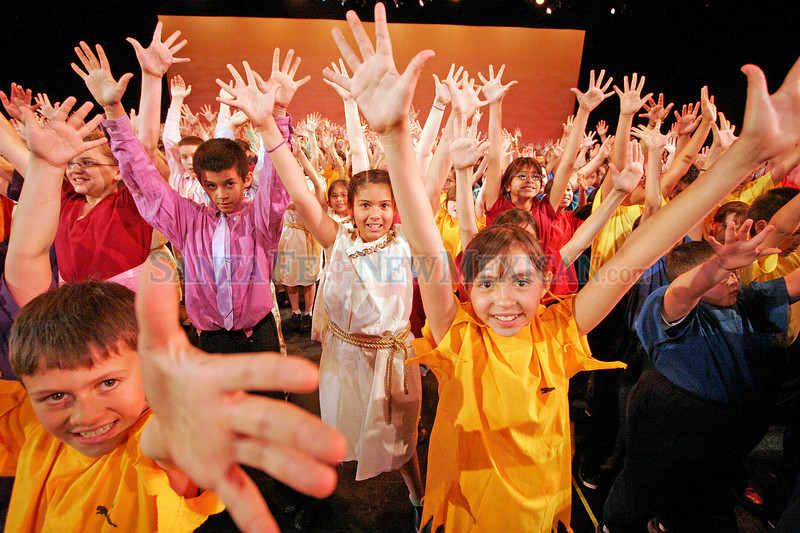 Mateo Vattano, 10, front left, and Karmine Mariscal, front right, 10, perform during a dressed rehearsal for Zing! Goes My Heart at the National Dance Institute of New Mexico on May 5, 2010.               Luis Sanchez Saturno/ The New Mexican.