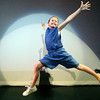 Maggie Bennett, 11, jumps into the spot light during a dressed rehearsal for Zing! Goes My Heart at the National Dance Institute of New Mexico on May 5, 2010.               Luis Sanchez Saturno/ The New Mexican.