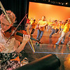 Stephanie Nagler, 15, left, plays the violin with the orchestra during a dressed rehearsal for Zing! Goes My Heart at the National Dance Institute of New Mexico on May 5, 2010.               Luis Sanchez Saturno/ The New Mexican.