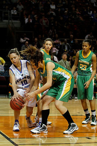 The first quarter of the Pecos High School vs Peñasco High School girls basketball game during the State Girls Basketball Tournament at the Santa Ana Star Center on Mar. 8, 2011.  Photo by Luis Sánchez Saturno/The New Mexican