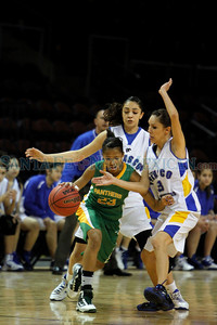 Pecos' Yeshemabet Turner, number 23,is double teamed by Peñasco's Abigail Soot, number 30, and Kimberly Vigil, number 13, during the first quarter of the Pecos High School vs Peñasco High School girls basketball game during the State Girls Basketball Tournament at the Santa Ana Star Center on Mar. 8, 2011.  Photo by Luis Sánchez Saturno/The New Mexican