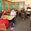 Coach Danny Tidwell, right, entertains some of the players with imitations of other teams players while having lunch at an Albuquerque restaurant on Mar. 11, 2010.         Luis Sanchez Saturno/ The New Mexican.