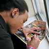 Rodney Coles signs a cheer card for a fan in his hotel room on Mar. 10, 2010.           Luis Sanchez Saturno/ The New Mexican.
