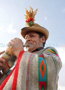 Pompeyo Berrocal Evanan of the Republic of Peru joins in the procession of folk artists to kick off the The Santa Fe International Folk Art Market at the Railyard park on Thursday, July 7, 2011. Photos by Jane Phillips/The New Mexican