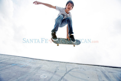 Masen Greer, 13, from Santa Fe, spends some of his free day from school skating at Franklin E. Miles Park on April 16, 2010.           Luis Sanchez Saturno/ The New Mexican.
