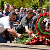 "Roses are laid by a wreath in remembrance of 911 during the City of Santa Fe, New Mexico Fire Department and the Santa Fe Firefighters 6th Annual ""Firefighter Day of Remembrance"" Parade on September 11, 2012. The parade began at Fire Station 1 at 200 Murales Road at 11:45 a.m. and proceeded down Washington Avenue to the Plaza where a wreath ceremony was held with guest speakers. Clyde Mueller/The New Mexican"