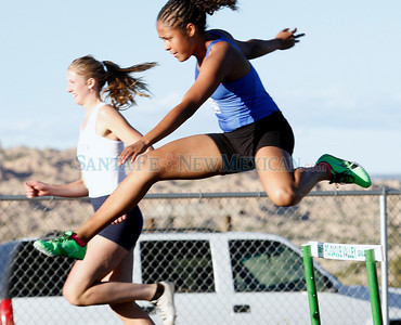 Mayah McGowan, of St. Michael's High School, qualifies for state in the 300m hurdles during a Pojoaque Track Invitational in Pojoaque, N.M. on March 31, 2011. Natalie Guillén/The New Mexican