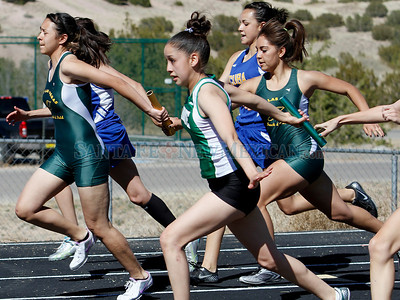Marissa Martinez (center) of Pojoaque, takes the baton during the 400m relay during a track Invitational in Pojoaque, N.M. on March 31, 2011. Natalie Guillén/The New Mexican