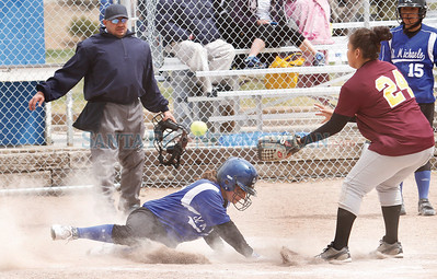 LEDE Erin Torrez, of St. Michael's, (right) slides safely into home while Santa Fe Indian School's pitcher, Andrea Sanchez, waits for the ball during a girls softball game in Santa Fe, N.M. on April 9, 2011. Natalie Guillén/The New Mexican