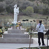 Monica Ashley, from Albuquerque, takes a look at Our Lady of La Vang, a Vietnamese saint outside the Santuario de Chimayo during the annual pilgrimage on Good Friday, April 18, 2014. Luis Sanchez Saturno/The New Mexican