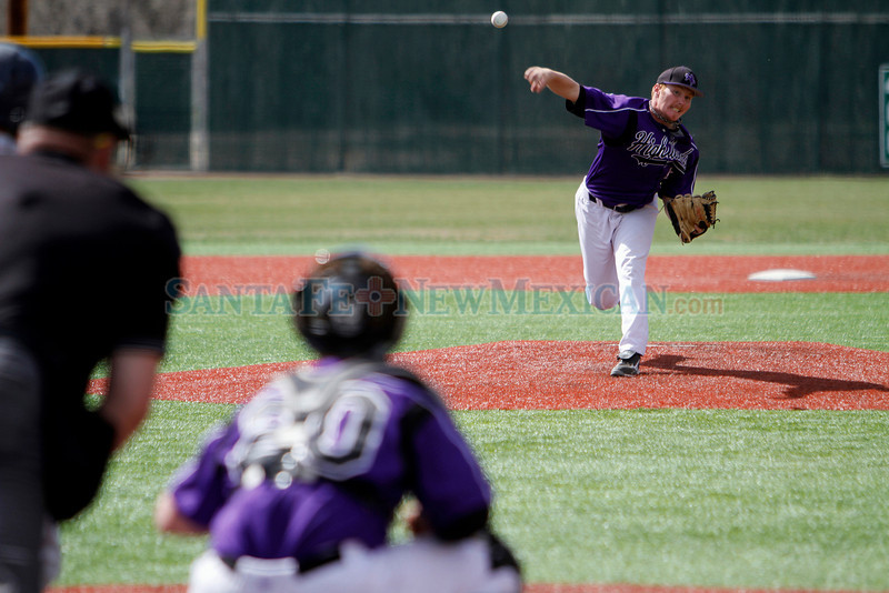Highlands pitcher Trent Evins, number 23, pitches during the top of the third inning of the New Mexico Highlands University vs Metro State at Highlands on April 8, 2011.<br /> <br /> Photo by Luis Sanchez Saturno/The New Mexican