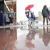 Lynette Payne, from Jacksonville, AR, walks around the Indigenous Fine Art Market during a light drizzle at the Rail Yard on Thursday, August 22, 2014.  Luis Sanchez Saturno/The New Mexican