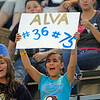 Emmaleigh Rivera, 13, from Santa Fe, holds up a sign for the Alva brothers during the second quarter of the Santa Fe High School vs Grants High School football game at Santa Fe High School on Friday, October 31, 2012. Photo by Luis Sanchez Saturno/The New Mexican