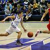 St.  Michael's Antonio Garcia,#4, drives the ball down court during the third quarter of their game against Bernalillo's captain Stephan Lujan, #21 at Perez-Shelly Gymnasium on Tuesday, December 14, 2010. St. Michael's was  up 55-47 the last two minutes of their game.<br /> Photos by Jane Phillips/The New Mexican